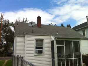 repaired roof with one new shingle