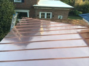 Hip and ridge detail on standing seam copper roof hip